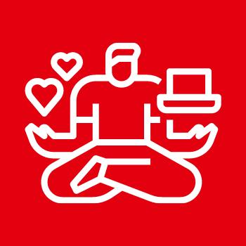 Symbolbild Leben und Arbeiten: Eine sitzende Person balanciert Herzen auf der einen Hand und einen Laptop auf der anderen Hand